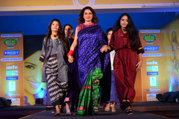 Acid attack survivors walk the ramp in city